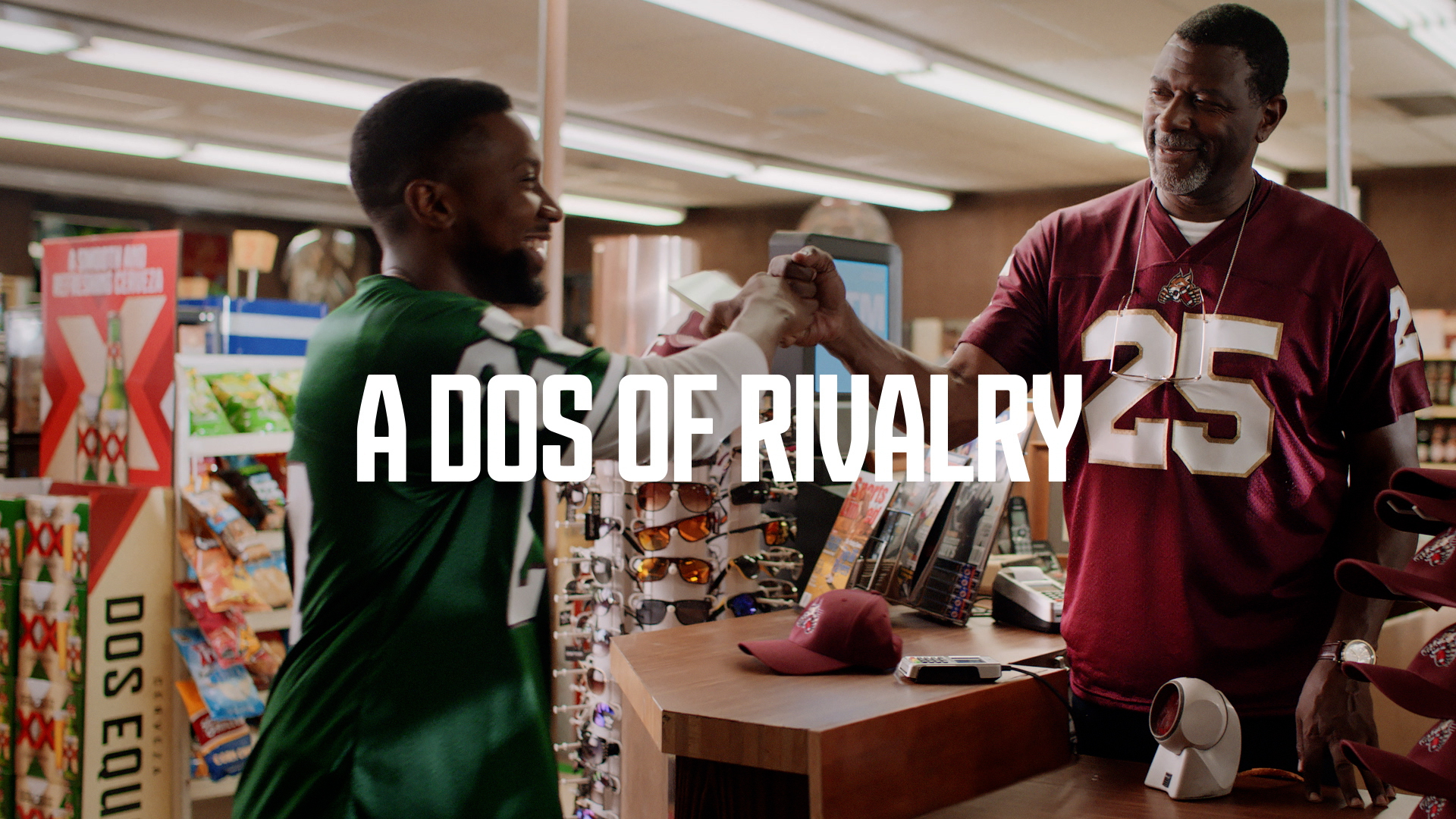 Two man rooting for rival teams fist bumping. Tag line that reads: A dos of rivalry.